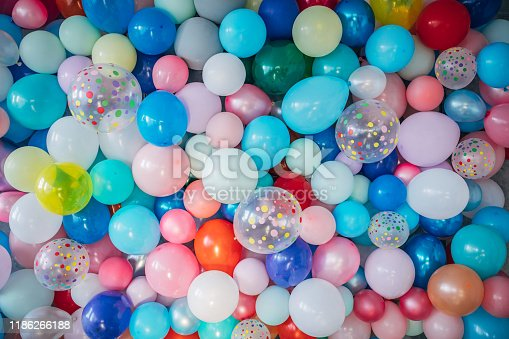 945748362istockphoto Multi-colored balloons as background 1186266188