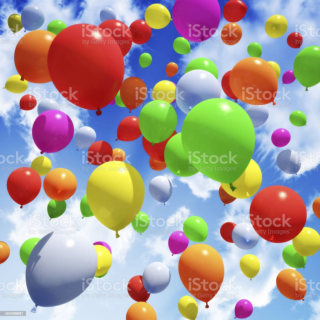 Multicolored Balloon's released into the sky stock photo