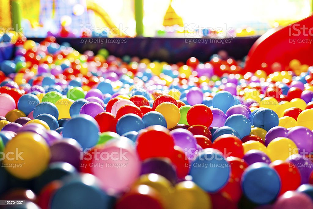 Multicolored balls in a playground stock photo