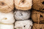 Multi-colored balls of yarn for knitting. Woolen threads for needlework.