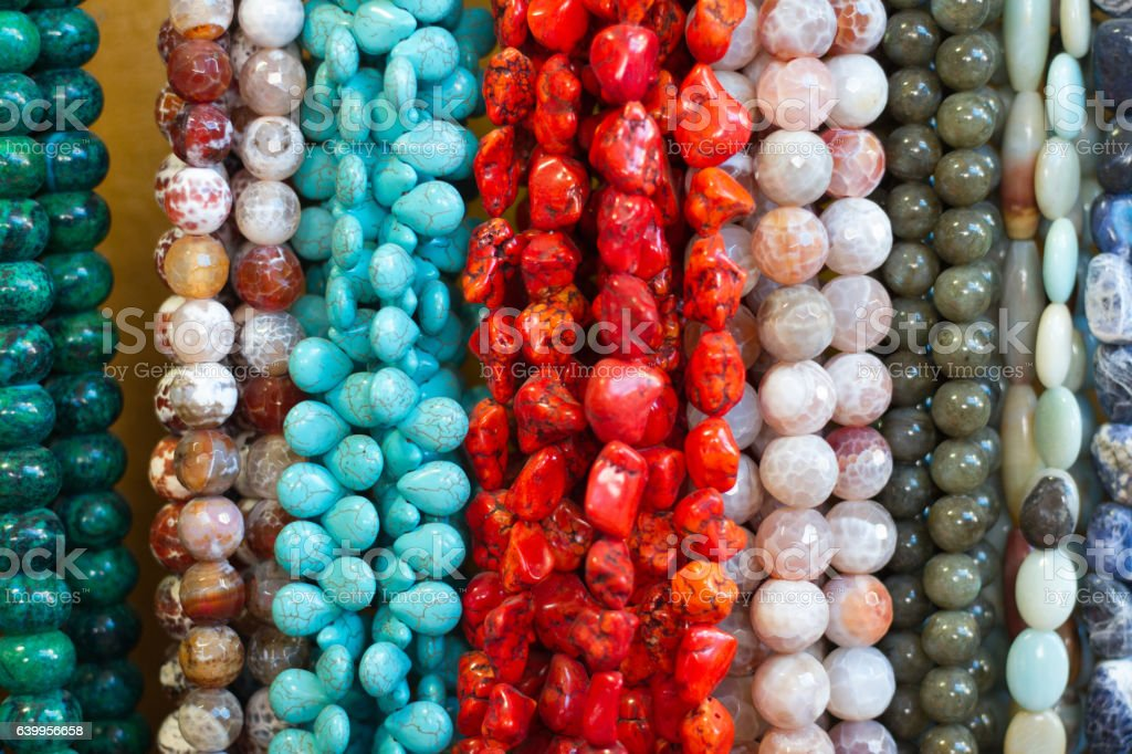 Multi-Colored Beads and Necklaces Hanging (Close-Up) stock photo