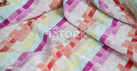 1150735049 istock photo Multi-colored big terry cotton towel close up 1137996210