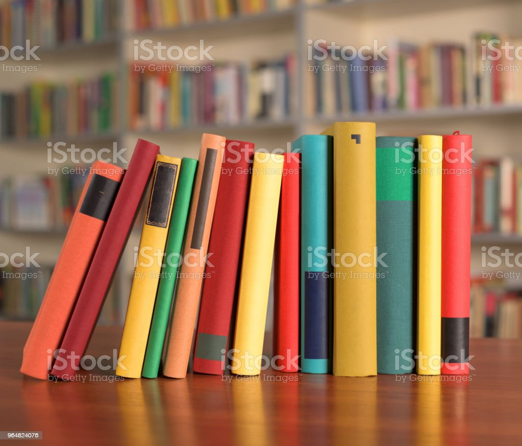 Multicolored books are on the table royalty-free stock photo