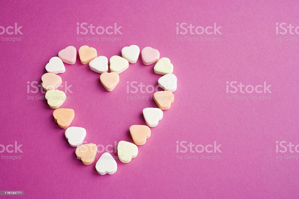 multicolored candy hearts arranged in the shape of a heart royalty-free stock photo