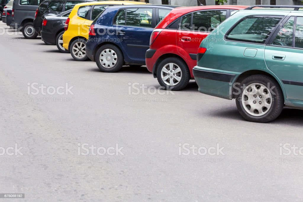 multicolored cars parked diagonally at parking lot in the street - foto de acervo