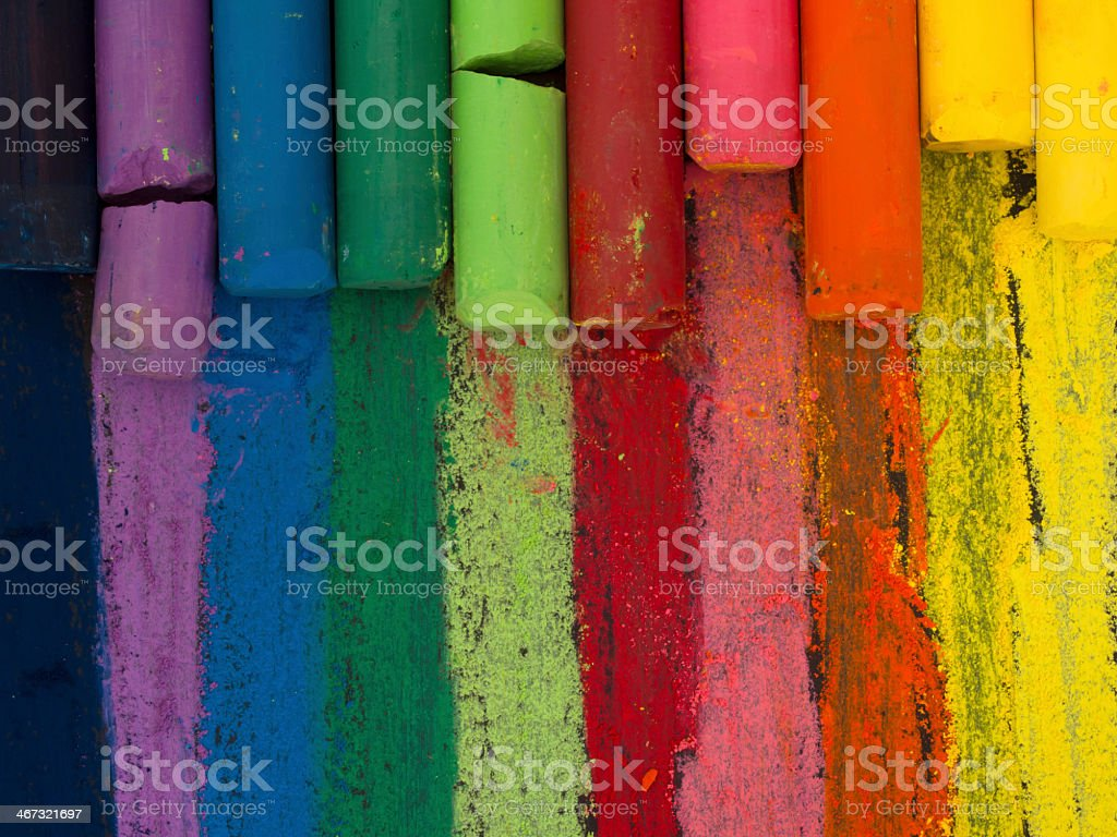 Multicolored chalk stripes with chalk pieces stock photo