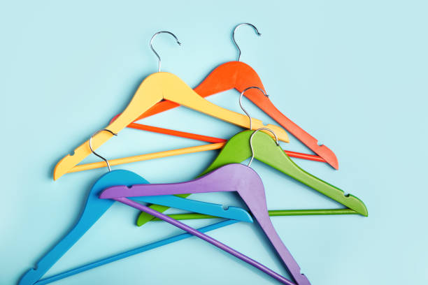 Multi-colored clothes hangers on a blue background. Concept of shopping and sale. stock photo