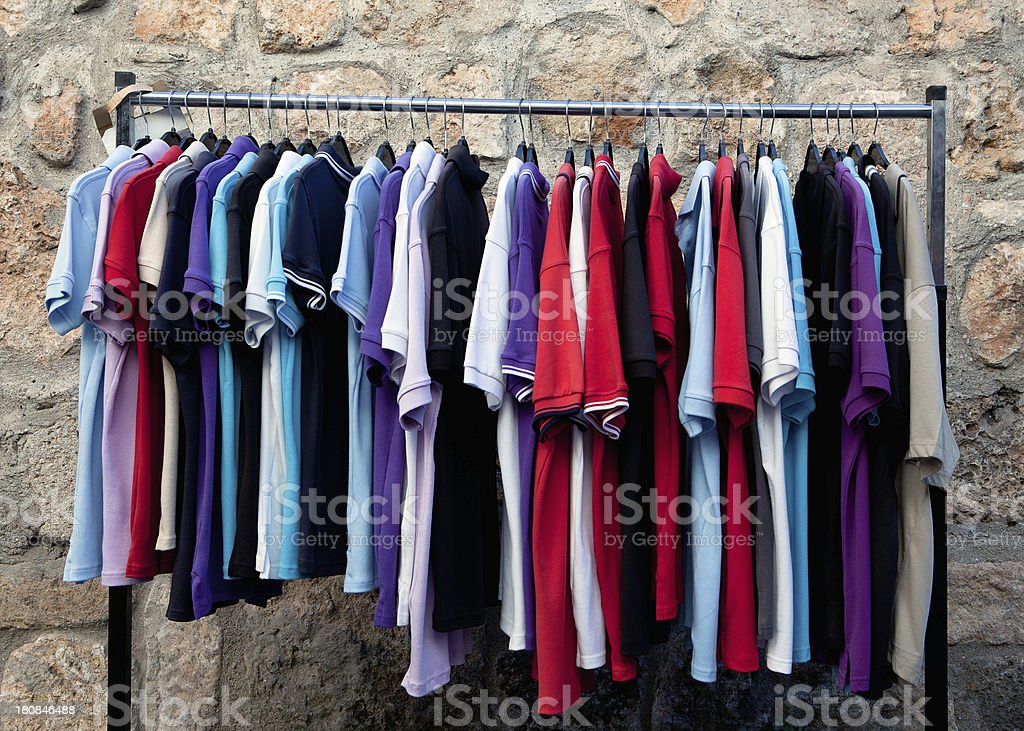 Multicolored clothes on hangers royalty-free stock photo