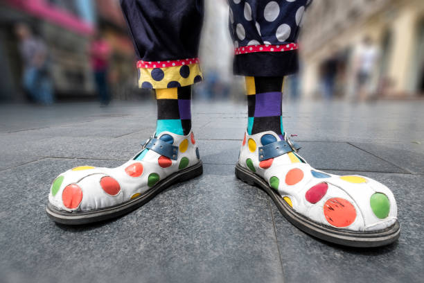 Multicolored clown shoes on the city street stock photo