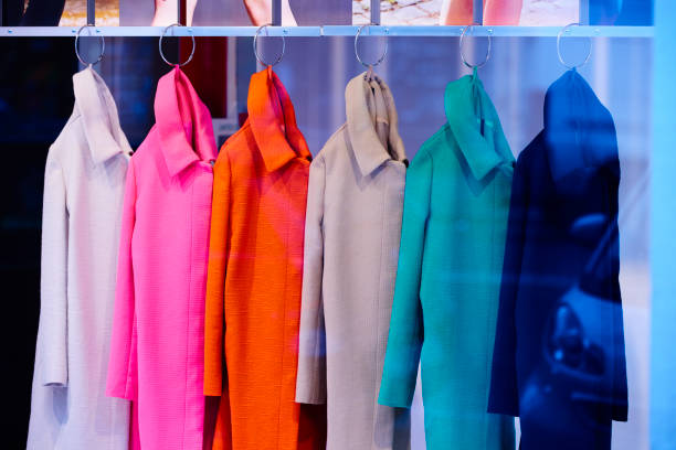 multicolored coats inside store side view of multicolored coats inside store. coat garment stock pictures, royalty-free photos & images