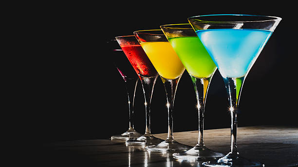 Multicolored cocktails Multicolored cocktails at the bar. martini stock pictures, royalty-free photos & images