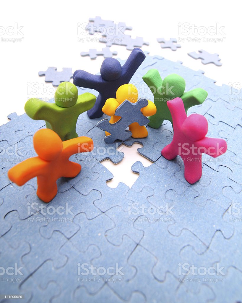 Multicolored colored cartoon people and a puzzle royalty-free stock photo