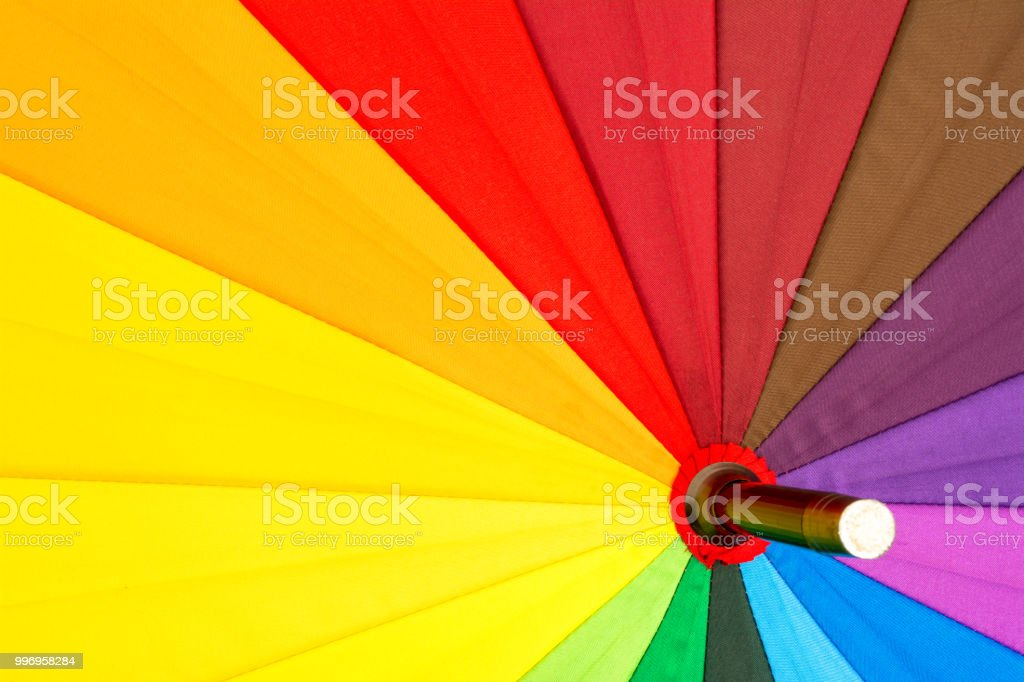 multicolored colorful umbrella with all colors of the rainbow bright