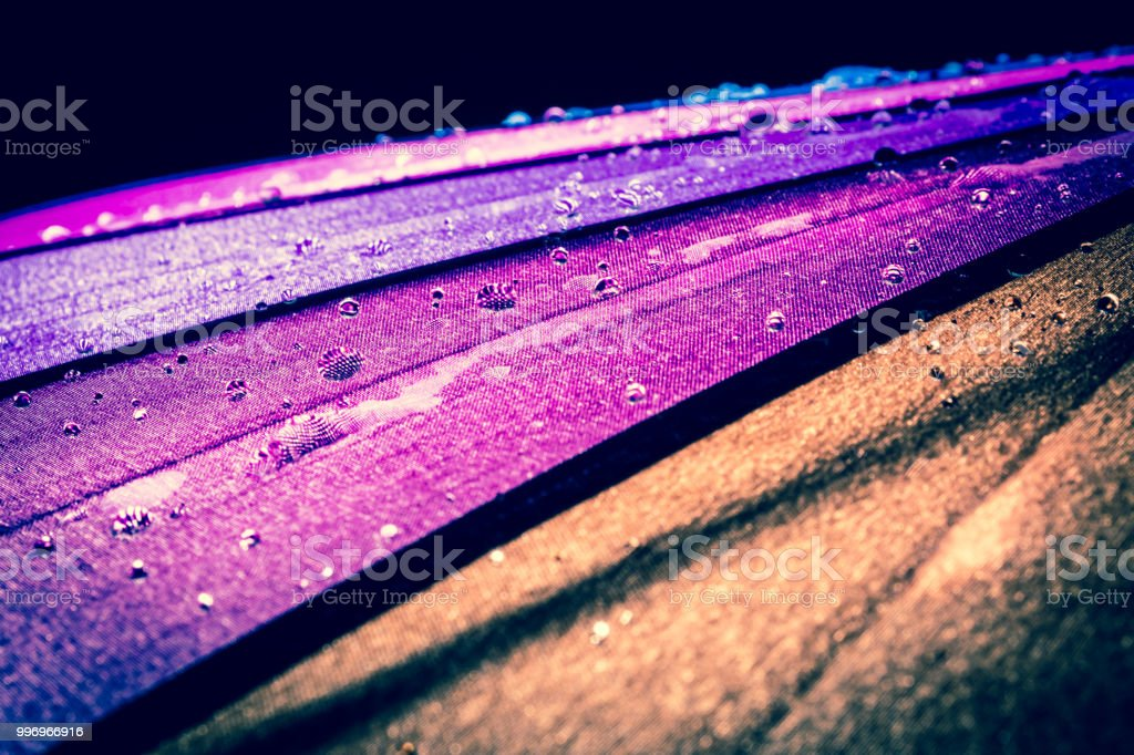 multicolored colorful umbrella with all colors of the rainbow with