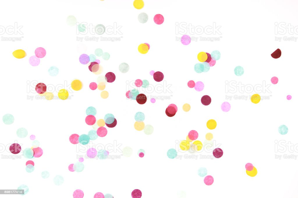 Multicolored confetti on white stock photo