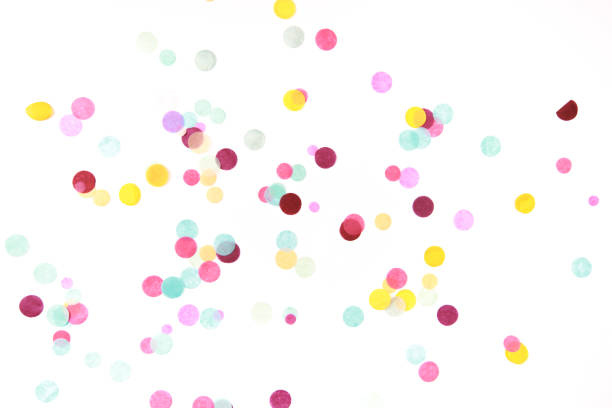 multicolored confetti on white - confetti stock pictures, royalty-free photos & images