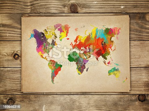 istock Multi-colored continents on a paper world map 169946316