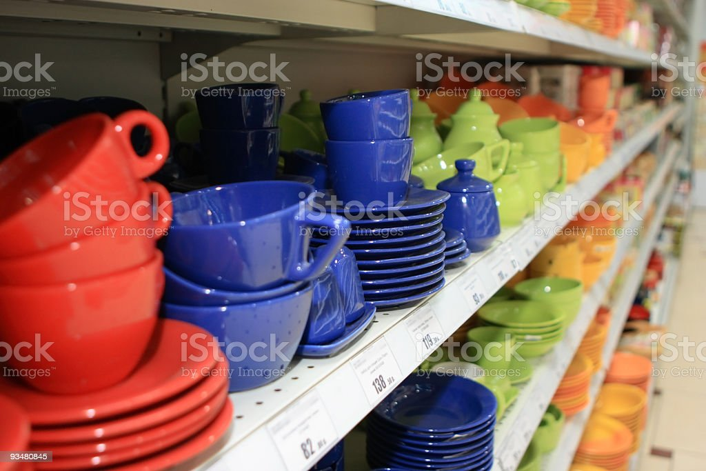 Multicolored cups on a store shelf royalty-free stock photo