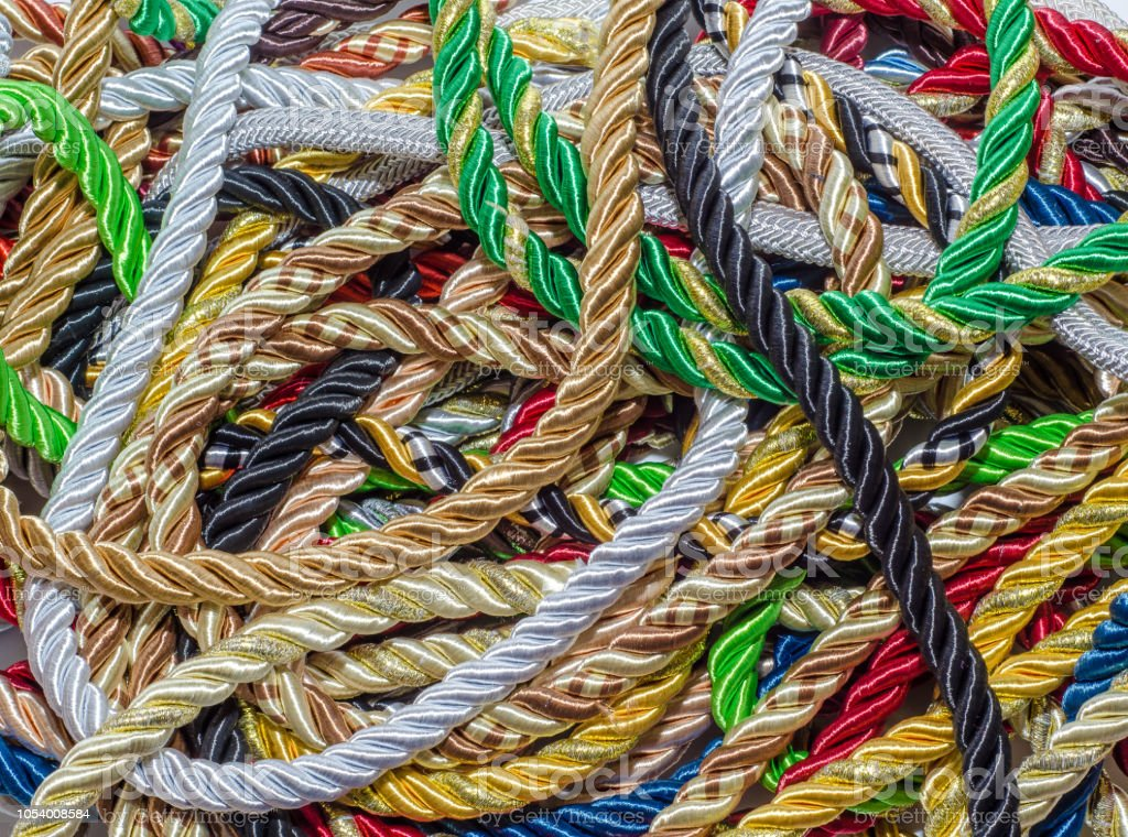 Multicolored Decorative Rope Scattered In A Mess Textile
