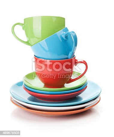 Colorful cups and saucers. Isolated on white background