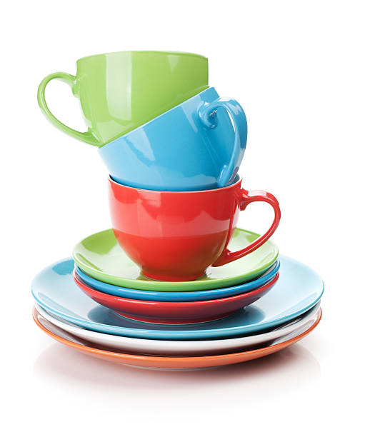 multicolored dishes on a white background - crockery stock photos and pictures