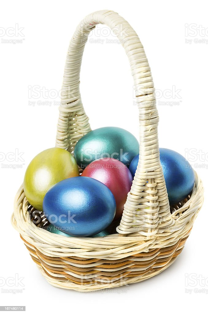 Multi-colored Easter eggs in basket with handle royalty-free stock photo