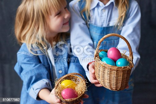 Girls holding Easter presents