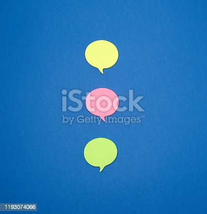 istock multicolored empty paper stickers in the form of clouds on a blue background 1193074066