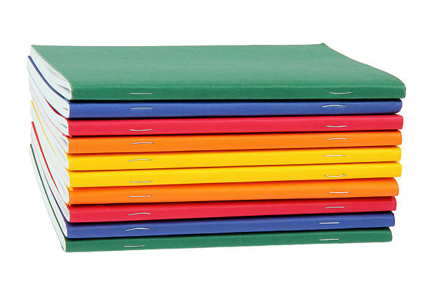 multicolored exercise books multicolored exercise books over the white background workbook stock pictures, royalty-free photos & images