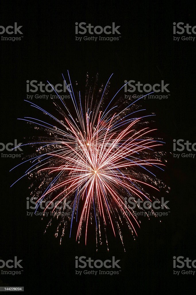 Multicolored exploding fireworks in night sky stock photo
