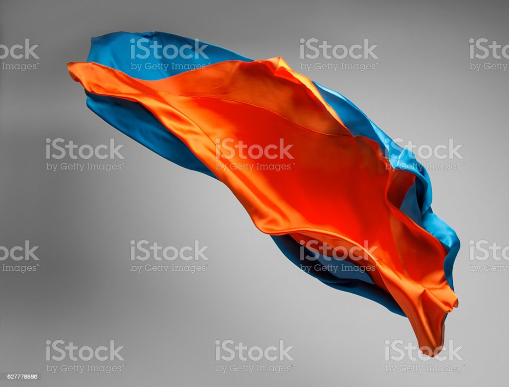 multicolored fabric in motion stock photo