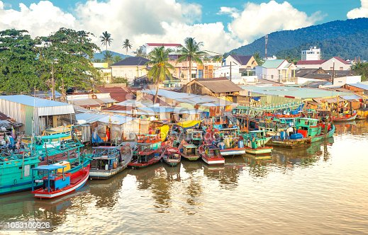 Multicolored fishing boats at the pier in the fishing village