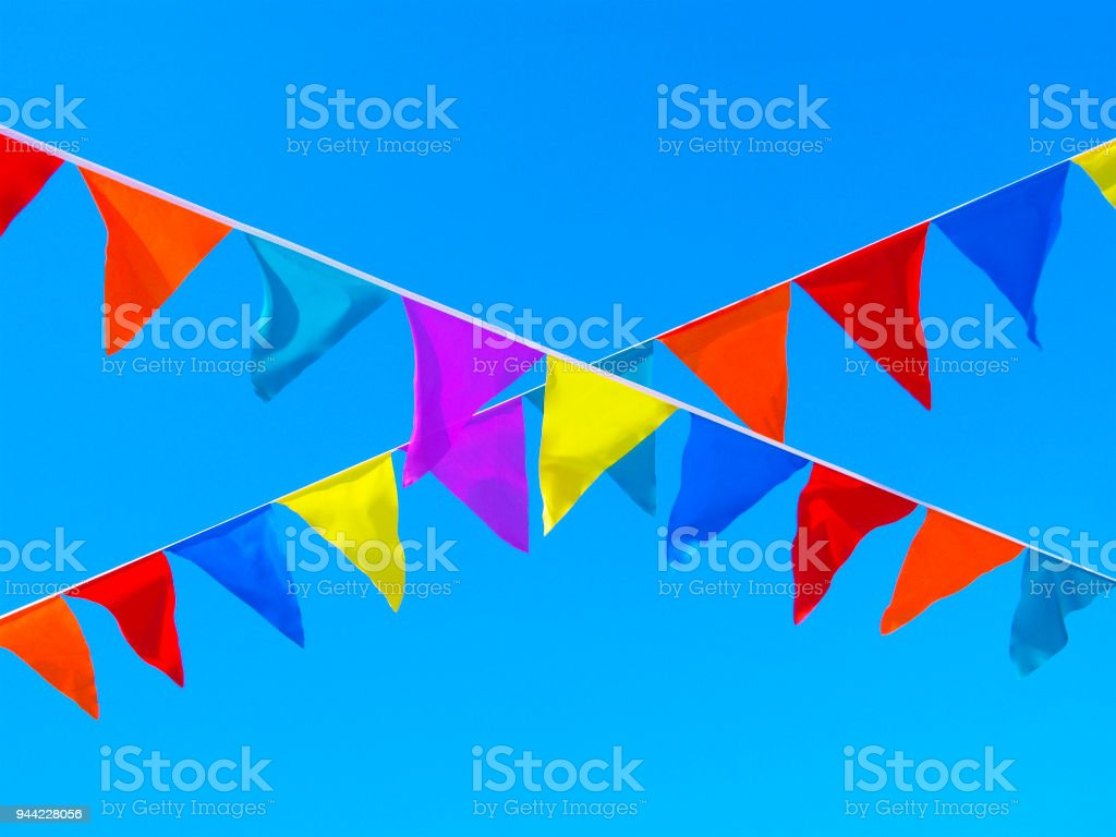 Multicolored flags, crossing ribbons in the sky stock photo