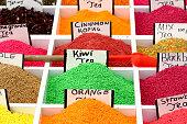 Multicolored flavored soluble granular tea on the market.