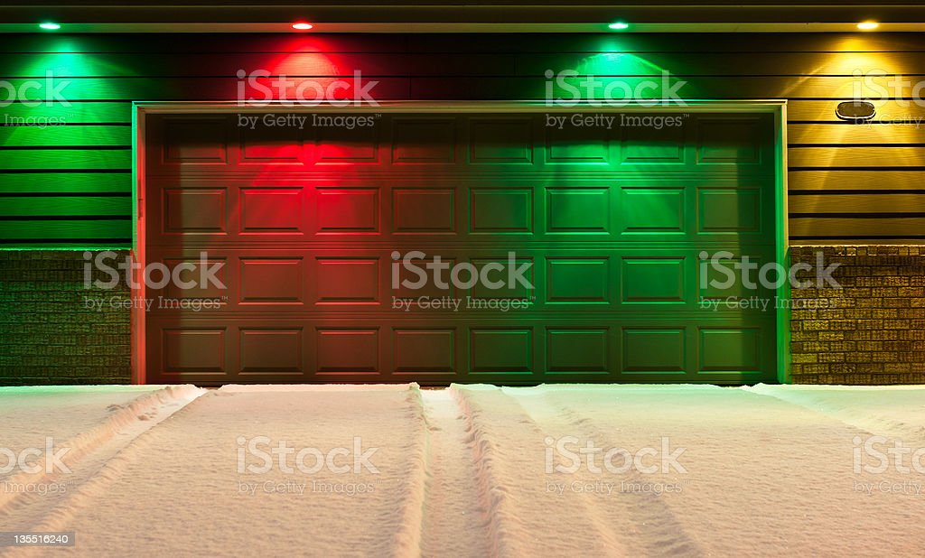 Multi-Colored Garage Door and Snowy Driveway stock photo