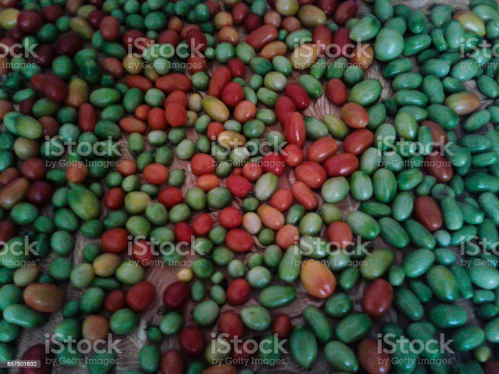Multicolored glossy tomatoes stock photo
