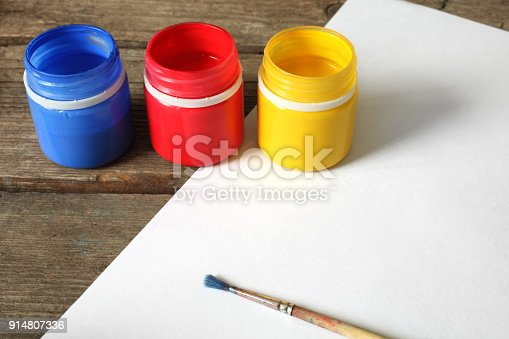istock Multicolored gouache paint, paper and brush 914807336