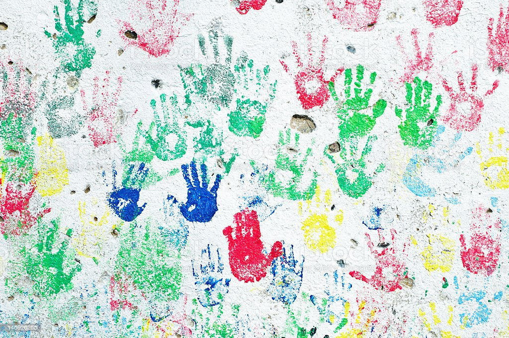 Multicolor handprints on the wall made by the kids.