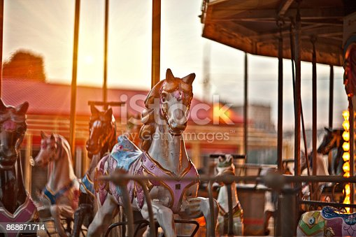 Multicolored horses on carousel at sunset in the city of Florence, the famous and amazing capital of the Italian Renaissance. Located in the Tuscany region