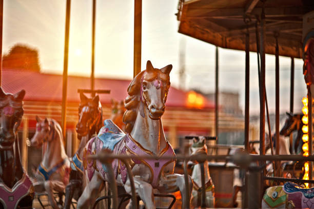 Multicolored horses on a carousel Multicolored horses on carousel at sunset in the city of Florence, the famous and amazing capital of the Italian Renaissance. Located in the Tuscany region paint horse stock pictures, royalty-free photos & images
