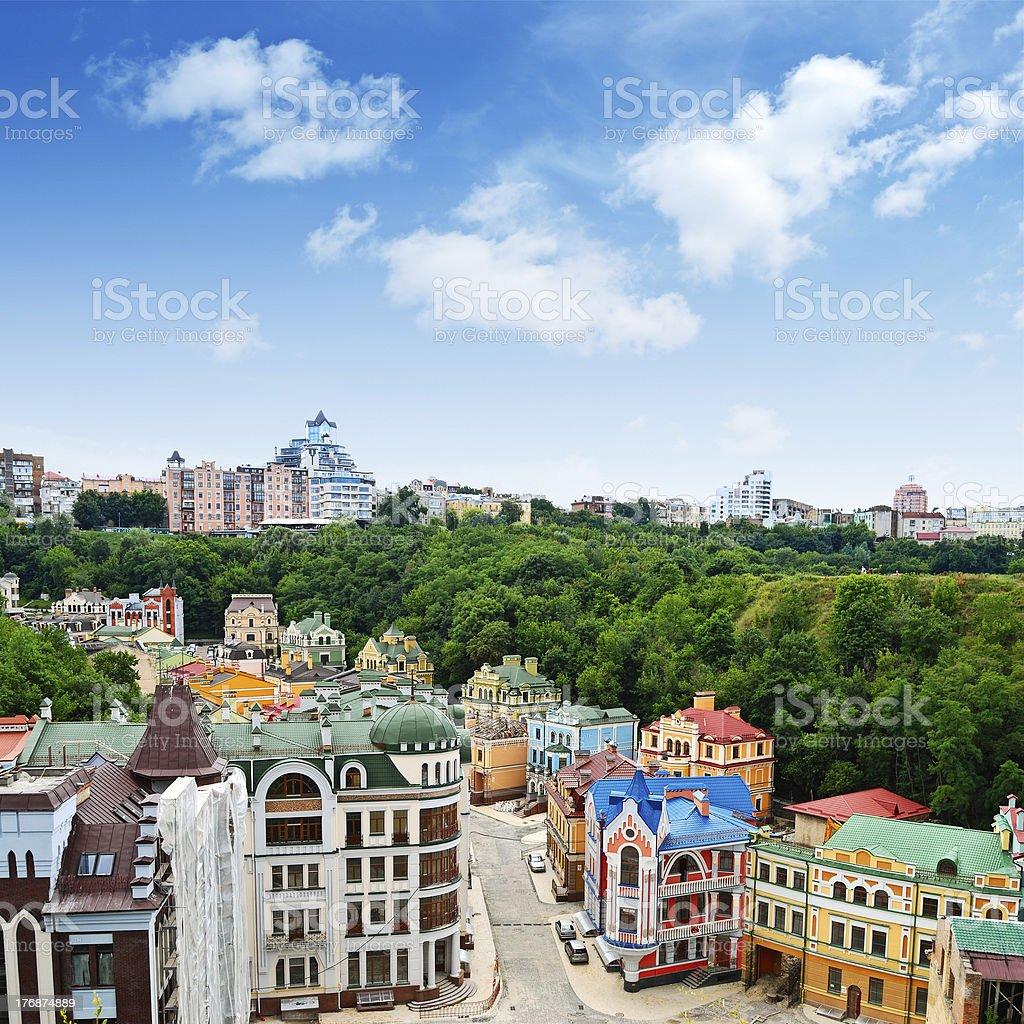 Multicolored houses among the green trees stock photo
