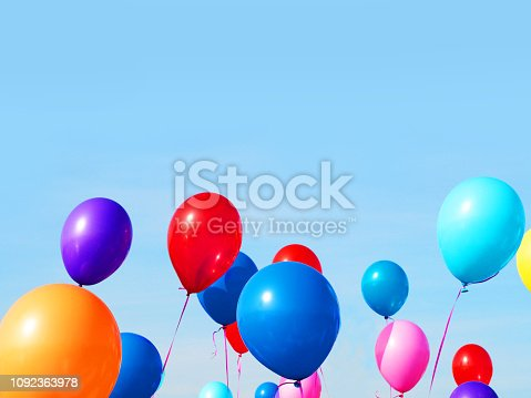 istock Multicolored inflatable balloons filled with helium against the blue sky. Concept of holiday, birthday, anniversary 1092363978
