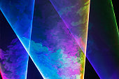 Multicolored laser lights and fog. Laser light show.