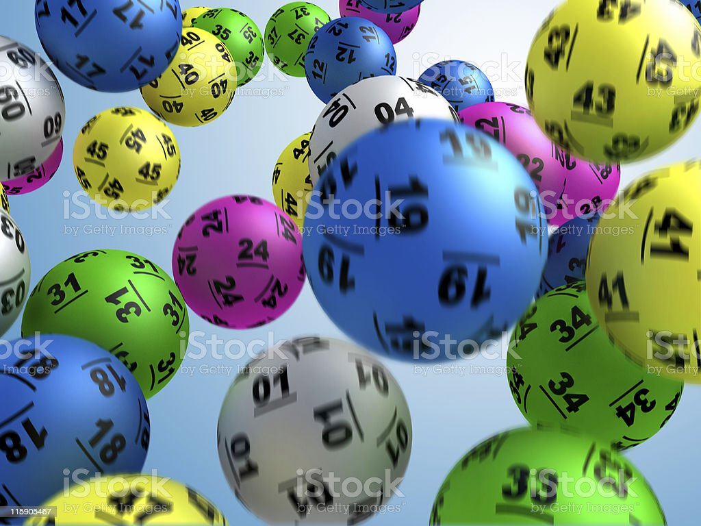 Multi-colored lottery balls suspended mid-air in flight stock photo