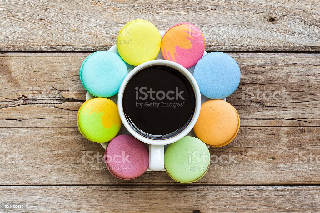 Multicolored macaroon on the old wooden table stock photo