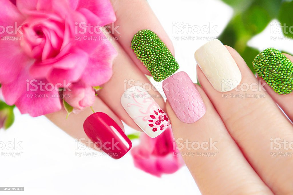 Multicolored manicure with flower. stock photo