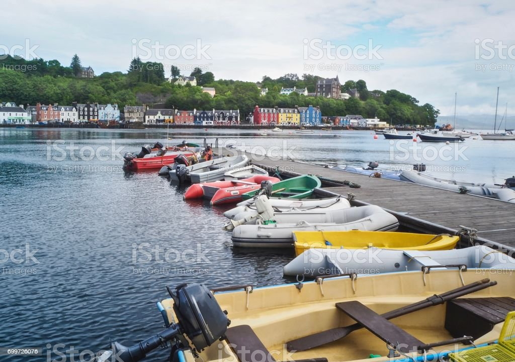 Multicolored Motor Rubber Boats  On Tobermory Town Background stock photo