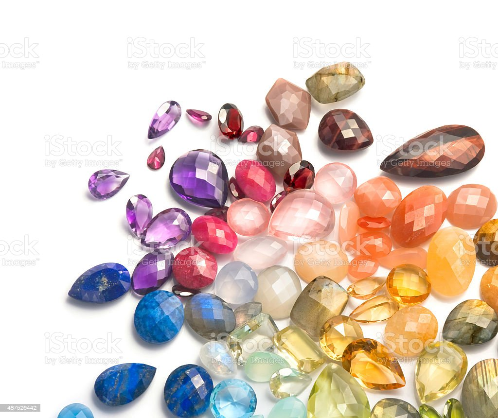 Multicolored natural gems on the white background. stock photo