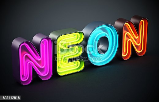 istock Multi-colored neon letters on black background 825112818
