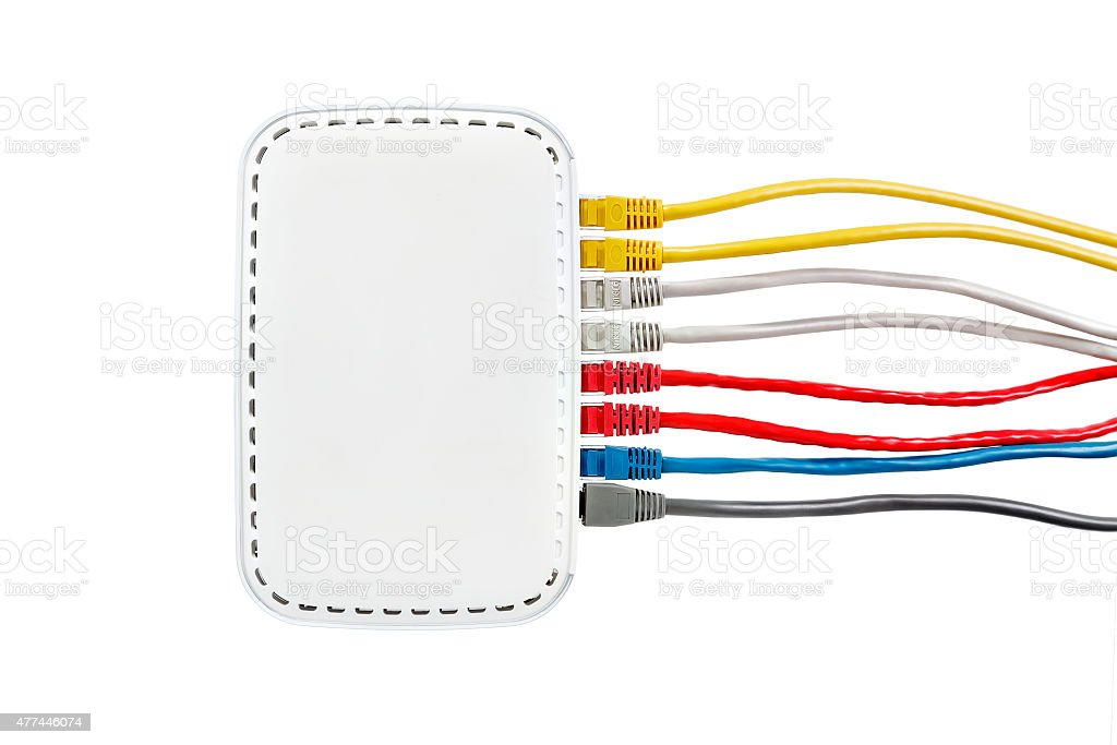 Multicolored network cables connected to router on a white background stock photo